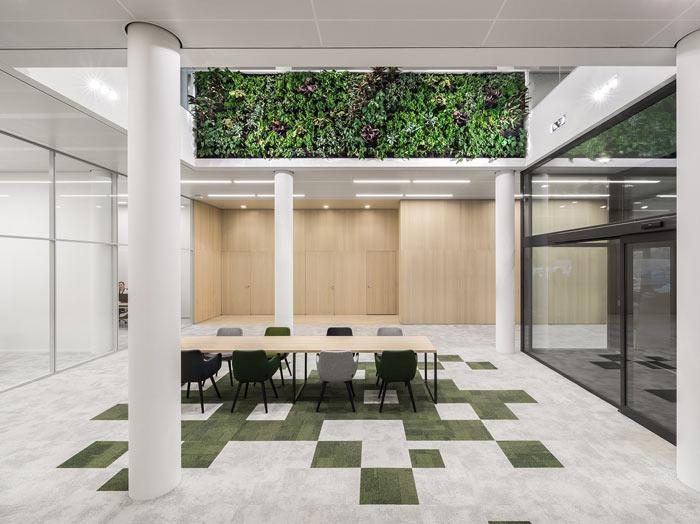 绿色食品公司办公室中庭装修设计效果图